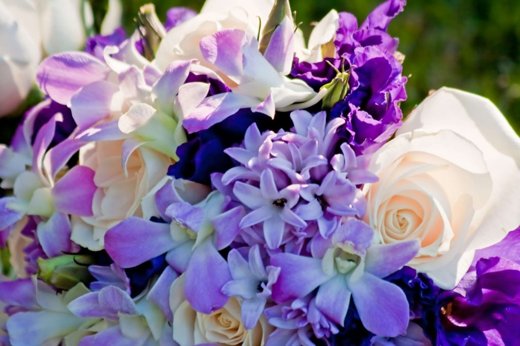 A wedding bouquet full of purple flowers
