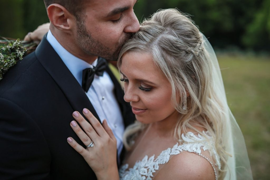 A closeup of a bride and groom hugging taken by Pixel Punk Photography